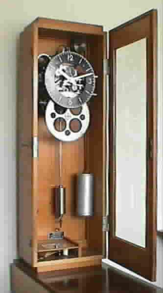 Mecanisme horloge poids